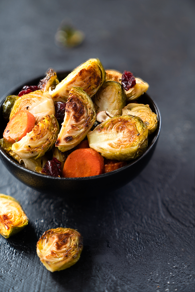 roasted Brussels sprouts with maple syrup, carrots, cranberries, and hazelnuts