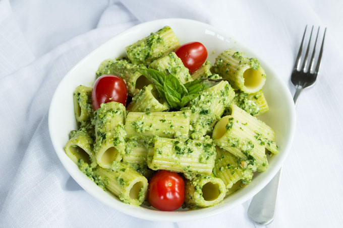 basil pesto pasta with pine nuts and charred tomatoes