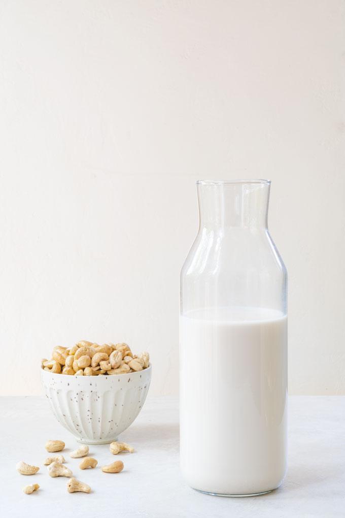 homemade cashew milk in a glass bottle