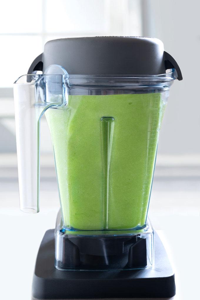 blending celery juice in a Vitamix blender